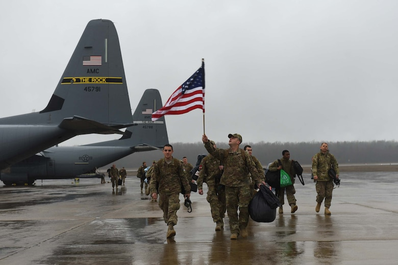 U.S. Air Force Airmen arrive home after a six-month deployment to Southwest Asia Jan. 19, 2017, at Little Rock Air Force Base, Ark. Team Little Rock Airmen specialize in providing rapid, global mobility to support humanitarian and wartime operations. (U.S. Air Force photo by Airman 1st Class Kevin Sommer Giron)
