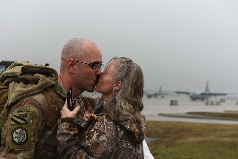 U.S. Air Force Tech. Sgt. Jason Caswell, 19th Aircraft Maintenance Squadron C-130J crew chief, reunites with his spouse after returning from a six-month deployment to Southwest Asia Jan 19, 2017, at Little Rock Air Force Base, Ark. Team Little Rock Airmen specialize in providing rapid, global mobility to support humanitarian and wartime operations.(U.S. Air Force photo by Airman 1st Class Kevin Sommer Giron)