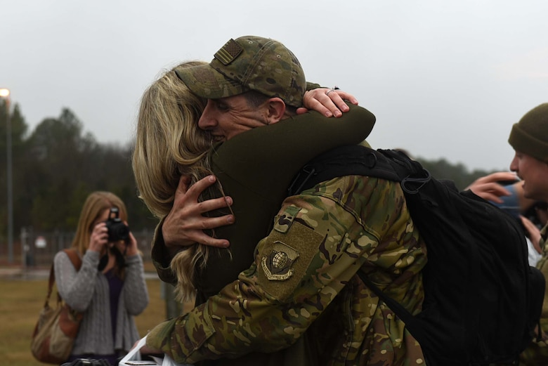A U.S. Air Force Airman reunites with his wife after returning from a six-month deployment to Southwest Asia Jan 19, 2017, at Little Rock Air Force Base, Ark. Team Little Rock Airmen specialize in providing rapid, global mobility to support humanitarian and wartime operations.  (U.S. Air Force photo by Airman 1st Class Kevin Sommer Giron)