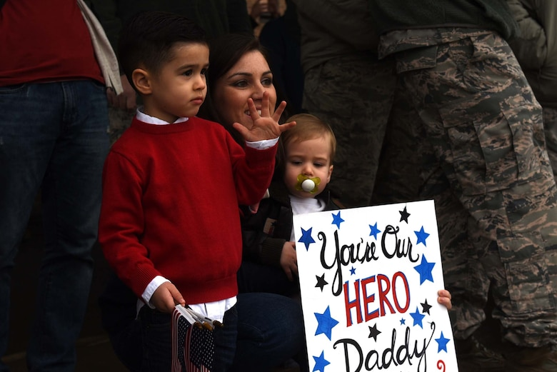 A family eagerly awaits the return of a U.S. Air Force Airman from a six-month deployment to Southwest Asia Jan. 19, 2017, at Little Rock Air Force Base, Ark. Team Little Rock Airmen specialize in providing rapid, global mobility to support humanitarian and wartime operations. (U.S. Air Force photo by Airman 1st Class Kevin Sommer Giron)
