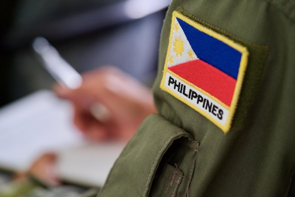Philippines Air Force Tech. Sgt. Primitivio Cedi Jr., an aerial reconnaissance photographer, writes notes about the ground-based, satellite imagery system called Eagle Vision during an introductory briefing, Clark Air Base, Philippines, Jan. 16, 2017. Cedi is one of 15 Philippine Airmen participating in a two-week long Subject Matter Expert Exchange with the U.S. Air Force. Cedi and the other Filipinos will exchange ideas and experiences on how the two nations can use satellite imagery to enhance their combined Humanitarian Assistance and Disaster Relief capabilities. (U.S. Air Force photo by Tech. Sgt. James Stewart/Released)