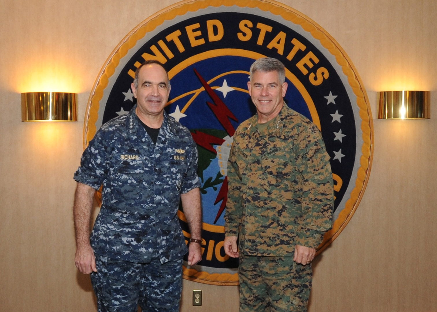 """Marine Corps Lt. Gen.  Joseph L. Osterman, right, U.S. Special Operations Command deputy commander, meets with Navy Vice Adm. Charles """"Chas"""" A. Richard, U.S. Strategic Command (USSTRATCOM) deputy commander, during his visit to USSTRATCOM Headquarters, Offutt Air Force Base, Nebraska, Jan. 18, to discuss the transfer of the Unified Command Plan-assigned Countering Weapons of Mass Destruction mission, ensuring full coordination of resources and mission responsibilities with senior leaders."""