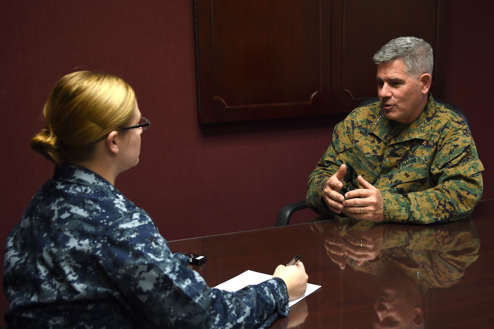Marine Corps Lt. Gen. Joseph L. Osterman, right, U.S. Special Operations Command deputy commander, conducts an interview during his visit to U.S. Strategic Command (USSTRATCOM) Headquarters, Offutt Air Force Base, Nebraska, Jan. 18.  While here, Osterman discussed the mission transfer of Countering Weapons of Mass Destruction, toured the Global Operations Center and received capabilities and integration briefings on nuclear command, control and communication, space, electronic warfare and cyber.