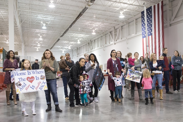 Family and friends await the return of Airmen from the 621st Contingency Response Wing, Jan. 14, 2017, at Travis Air Force Base, California. The Airmen were returning from a three-month deployment to Iraq, in support of Operation Inherent Resolve. (U.S. Air Force Photo by Tech. Sgt. Liliana Moreno)