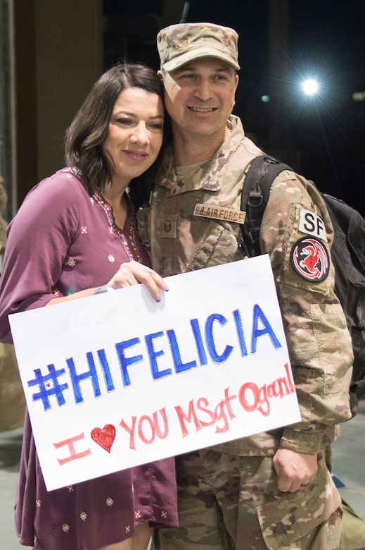 Master Sgt. Matthew Ogan, 921st Contingency Response Squadron Force Protection Flight chief, poses for a picture with his wife as he returns from a three-month deployment to Iraq, in support of Operation Inherent Resolve, Jan. 14, 2017, at Travis Air Force Base, California.  The CRW played a crucial role in re-opening Qayyarah West Airfield and moving more than 1,423 short tons of cargo in and out of the region. (U.S. Air Force Photo by Tech. Sgt. Liliana Moreno)