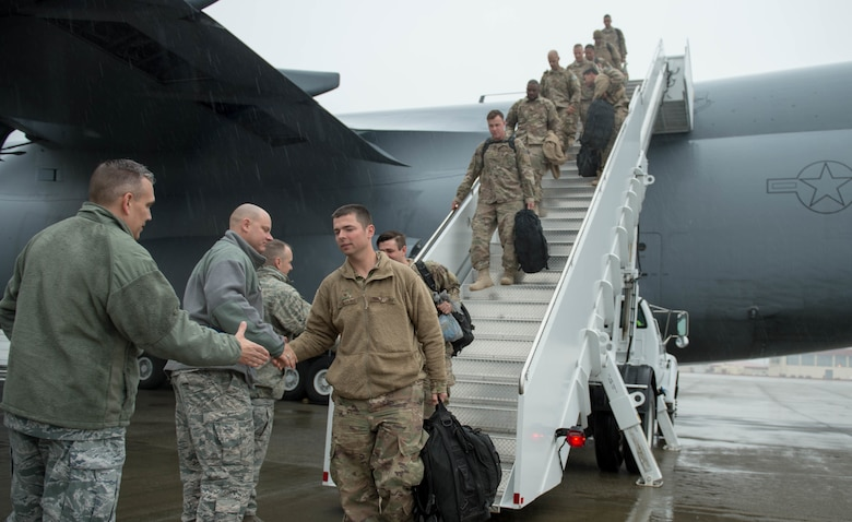 621st Contingency Response Wing leadership greets Airmen as they return from a three-month deployment to Iraq, in support of Operation Inherent Resolve, Jan. 18, 2017, at Travis Air Force Base, California. The CRW played a crucial role in reopening Qayyarah West Airfield and moving more than 1,423 short tons of cargo in and out of the region. (U.S. Air Force Photo by Staff Sgt. Robert Hicks)