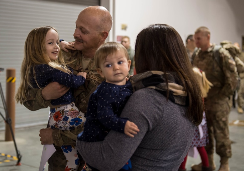 Lt. Col. Blaine Baker, 821st Contingency Response Element commander, hugs his daughter as he returns from a three-month deployment to Iraq, in support of Operation Inherent Resolve, Jan. 18, 2017, at Travis Air Force Base, California. The CRW played a crucial role in reopening Qayyarah West Airfield and moving more than 1,423 short tons of cargo in and out of the region. (U.S. Air Force Photo by Staff Sgt. Robert Hicks)
