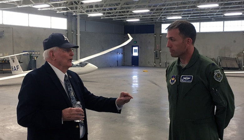 Retired Lt. Col. James Leland chats with Lt. Col. Jeremy Lushnat, commander of the 94th Flying Training Squadron, during his fall 2016 visit to the U.S. Air Force Academy. Leland assisted with the design of the airfield and the Academy's Airmanship Program the early 1960's. (Courtesy photo)