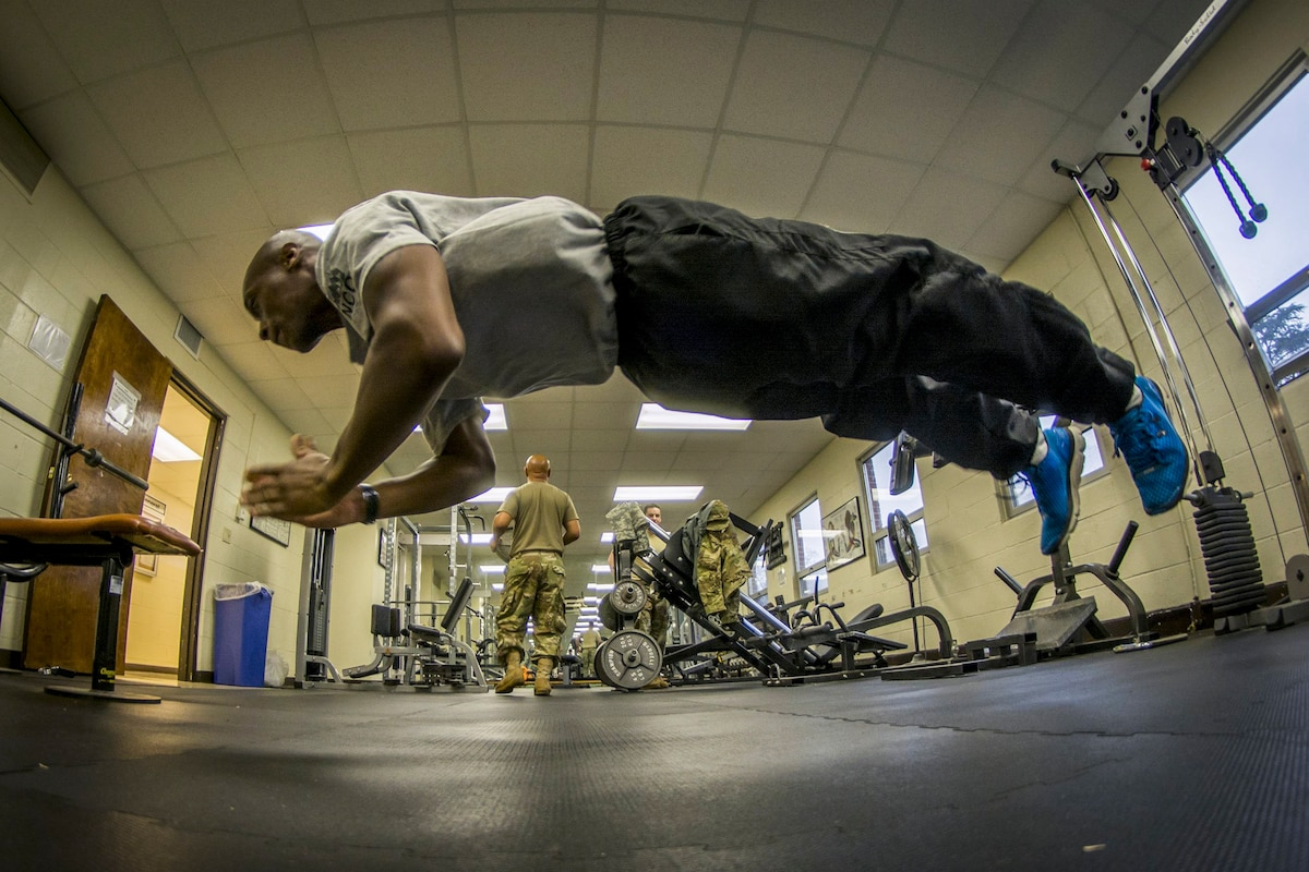 A Reserve soldier does pushups in a headquarters.