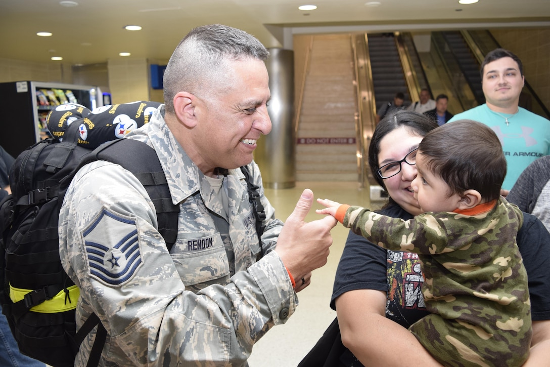 Master Sgt. Rueben Rendon Jr., 433rd Security Forces Squadron, meets his grandson, Derreck Anguiano, for the first time upon his return Jan. 19, 2017 at the San Antonio International Airport, Texas. Thirteen Citizen Airmen returned from a six-month deployment to Southwest Asia in support of Operation Inherent Resolve.
