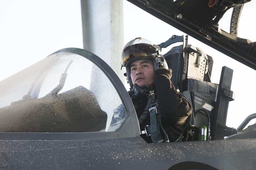Republic of Singapore Air Force Senior Lieutenant Colonel Tham Yeow Min, 428th Fighter Squadron senior-ranking officer, prepares for his final flight, Jan. 17, 2017, at Mountain Home Air Force Base, Idaho. Tham has served as the SRO since June 2013. Tham has served at the commander of the Peace Carvin V detachment since June 2013. (U.S. Air Force photo by Senior Airman Malissa Lott/Released)