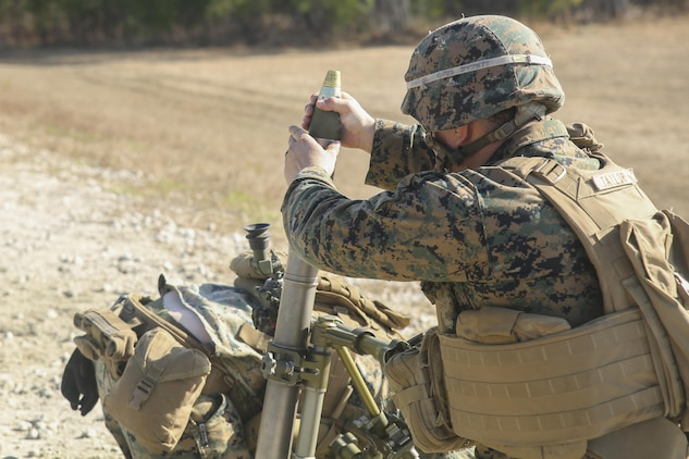 A Marine with Task Force Southwest inserts a round into an M224 60mm mortar during a live-fire training event at Camp Lejeune, N.C., Jan. 18, 2016. Approximately 30 Marines with the unit practiced firing, cleaning and practicing immediate action techniques on the weapon as part of their preparation for an upcoming deployment to Helmand Province, Afghanistan. Task Force Southwest is comprised of about 300 Marines, whose role will be to train, advise and assist the Afghan National Army 215th Corps and the 505th Zone National Police as part of NATO's Resolute Support mission. (U.S. Marine Corps photo by Sgt. Lucas Hopkins)
