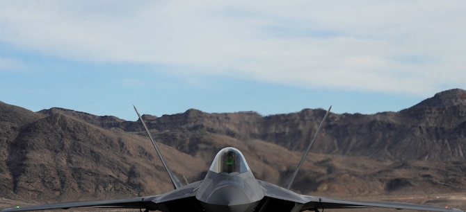 An F-22 Raptor assigned to the 1st Fighter Wing, Joint Base Langley-Eustis, Va., taxis on the flightline of Nellis Air Force Base, Nev., before participating in Red Flag 17-1, Jan. 18, 2017. Red Flag provides combat training in a degraded and operationally limited environment making the training missions as realistic as possible. (U.S. Air Force photo by Airman 1st Class Kevin Tanenbaum/Released