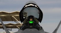 An F-22 Raptor pilot assigned to the 1st Fighter Wing, Joint Base Langley-Eustis, Va., removes his helmet after landing on Nellis Air Force Base, Nev., Jan. 18, 2017. Red Flag missions are conducted on the 2.9 million acres of the Nevada Test and Training Range with 1,900 possible targets, realistic threat systems and opposing enemy forces. (U.S. Air Force photo by Airman 1st Class Kevin Tanenbaum/Released)