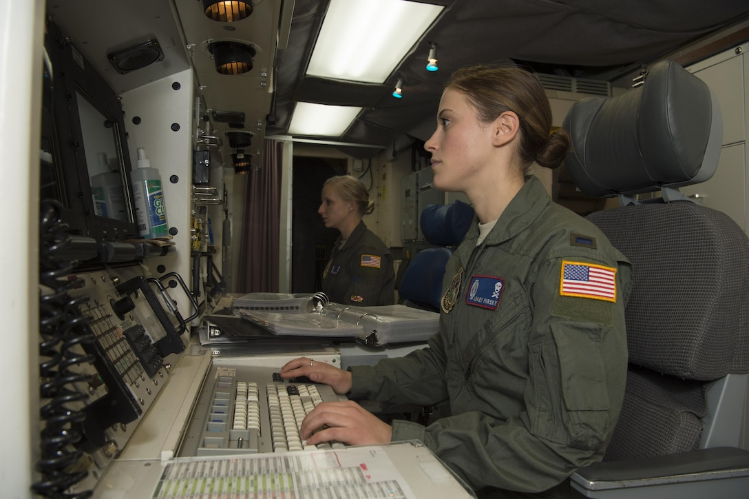 First Lt. Ashley Mirsky, 319th Missile Squadron missile combat crew commander, and 2nd Lt. Marie Blair, 319th MS deputy missile combat crew commander, check their monitors in a launch control center in the 90th Missile Wing missile complex, Dec. 19, 2016. The crew ensures they execute the mission safely, securely and effectively by holding each other accountable on job knowledge and striving to always improve. (U.S. Air Force photo by 1st Lt. Veronica Perez)