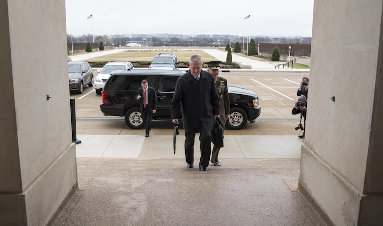 Secretary of Defense James Mattis greets U.S. Marine Corps Gen. Joseph Dunford, Chairman of the Joint Chiefs of Staff, after arriving at the Pentagon in Washington, D.C., Jan. 21, 2017.  (DOD photo by Air Force Tech. Sgt. Brigitte N. Brantley)