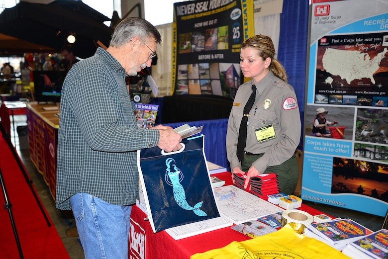 Amber Jones, park ranger at the U.S. Army Corps of Engineers Nashville District's J. Percy Priest Lake in Nashville, Tenn., talks with Karlos Thomas from Mt. Juliet, Tenn., during the 31st annual Progressive Nashville Boat & Sportshow at the Nashville Music City Center Jan. 20, 2017.
