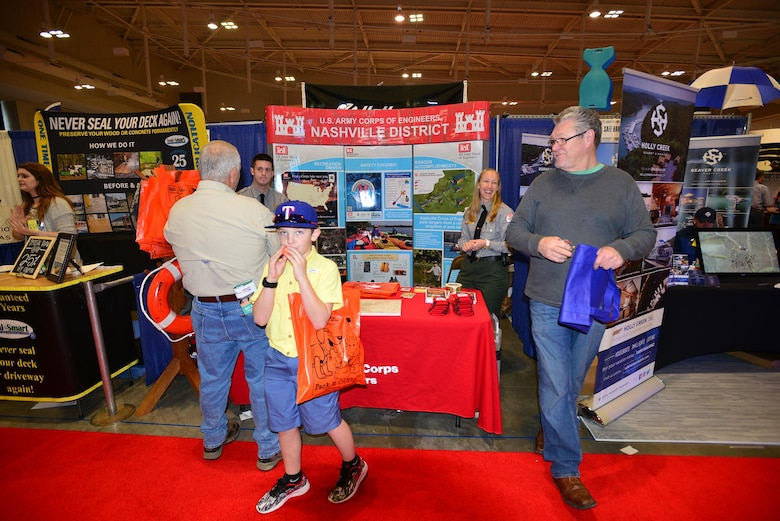 Lindsey Sullivan and Kyle Beverly, both park ranger at the U.S. Army Corps of Engineers Nashville District's J. Percy Priest Lake in Nashville, Tenn., talk with boating enthusiasts during the 31st annual Progressive Nashville Boat & Sportshow at the Nashville Music City Center Jan. 22, 2017.