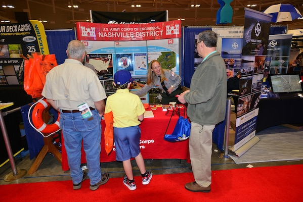 Lindsey Sullivan, park ranger at the U.S. Army Corps of Engineers Nashville District's J. Percy Priest Lake in Nashville, Tenn., talks with boating enthusiasts that stopped by the Corps of Engineers booth at the 31st annual Progressive Nashville Boat & Sportshow at the Nashville Music City Center Jan. 22, 2017.