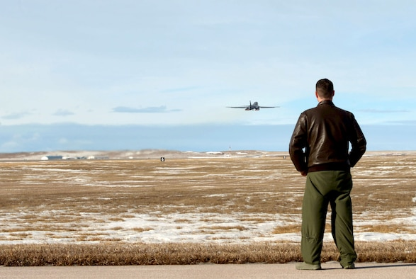 Maj. Jonathan Vogel, the 28th Bomb Wing commander's executive officer, watches as a B-1 bomber takes to the sky at Ellsworth Air Force Base, S.D., Jan. 20, 2017. Five B-1's flew to Nellis Air Force Base, Nev., to participate in Red Flag – a joint exercise training aircrew and pilots from across the world in air-to-air combat. (U.S. Air Force photo by Airman 1st Class Donald C. Knechtel)