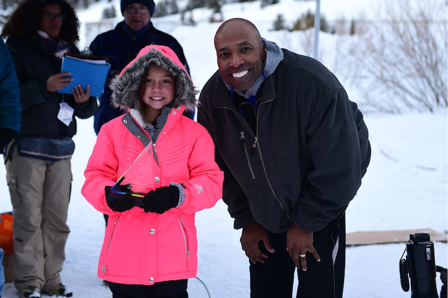 Jordan, a Team Buckley youth, and Col. Troy Dunn, 10th Air Base Wing Commander at U.S. Air Force Academy in Colorado Springs, Colo., pose for a photo Jan 21, 2017, at Copper Mountain, Colo. Jordan competed in the cardboard derby race and won the fastest down the hill award. (U.S. Air Force photo by Airman Jacob Deatherage/Released)