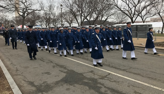 Cadets from each cadet squadron and other U.S. Air Force Academy representatives, march Jan. 20, 2017, in the Inaugural Parade in Washington. The cadets were among the 1,500 cadets, midshipmen and staff of the other service academies who marched in the parade to honor President Donald Trump. (U.S. Air Force photo/Staff Sgt. Veronica Cruz)