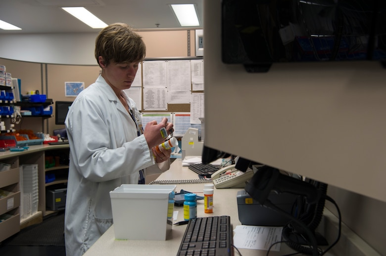 Natasha Kalda, 90th Medical Support Squadron pharmacist, fulfills prescriptions at F.E. Warren Air Force Base, Wyo., Jan. 20, 2017. The Air Force celebrates Biomedical Science Corps Appreciation Week Jan. 23 to 27. The Biomedical Science Corps is comprised of 15 medical AFSCs of which 10 are represented at F.E. Warren. (U.S. Air Force photo by Staff Sgt. Christopher Ruano)