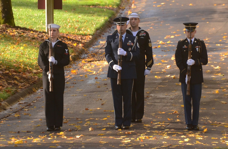 Oregon Air National Guard Tech. Sgt. Justin Meininger (center) is part of a joint military funerals honor guard Firing Party team, composed with U.S. Navy Reservist Information Systems Technician 3rd Class Tyler Swallow-Jones (left) and Master-at-Arms Petty Officer 1st Class Noel Flynn (center-right) as well as the Oregon Army National Spec. Anthony VanLaarhoven (right) present a rifle salute during a formal military service at Willamette National Cemetery, Portland, Ore., Oct. 28, 2016. (U.S. Air National Guard photo by Tech. Sgt. John Hughel, 142nd Fighter Wing Public Affairs)
