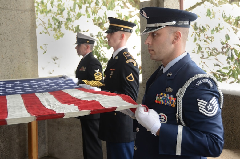 Oregon Air National Guard Tech. Sgt. Justin Meininger, right, along with Army National Guard Private First Class Chris Bourgo, center, and U.S. Navy Electronics Technician Chief Petty Office Jim Cameron, left, perform military funeral honors during a weekly memorial service at Willamette National Cemetery, Portland, Ore., Jan. 13, 2017. (U.S. Air National Guard photo by Tech. Sgt. John Hughel, 142nd Fighter Wing Public Affairs)
