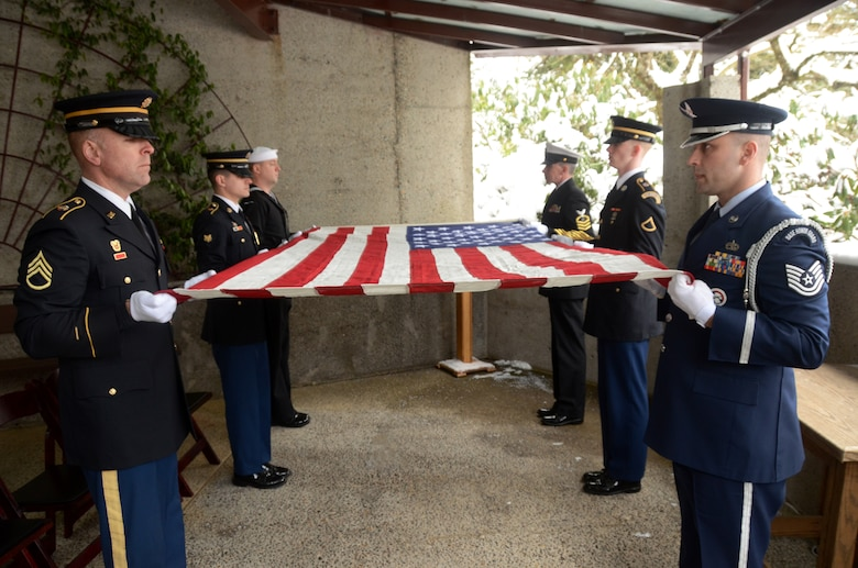 Members of the U.S. Navy reserve along with members of the Oregon National Guard Army and Air National Guard form a 6-man team as they perform military funeral honors during a weekly memorial service at Willamette National Cemetery, Portland, Ore., Jan. 13, 2017. (U.S. Air National Guard photo by Tech. Sgt. John Hughel, 142nd Fighter Wing Public Affairs)
