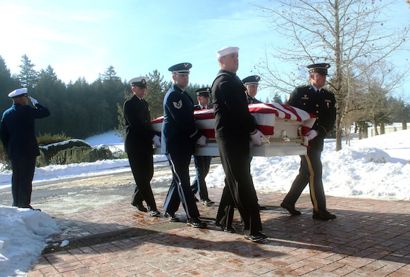 A joint service military funeral honor guard team consisting of U.S. Navy Reservist, and Oregon Army and Air National Guard members work in unison as pallbearers during a U.S. Coast Guard funeral at Willamette National Cemetery, Portland, Ore., Jan. 16, 2017. (Photo courtesy of U.S. Air Force Master Sgt. (ret.) Jonathan Dyer)
