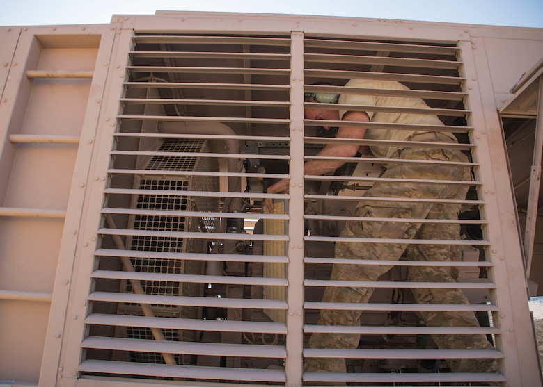 Staff Sgt. Gregory Speed, a 370th Air Expeditionary Advisory Group Detachment 1 electrician craftsman, removes an air filter from a generator at Al Asad Air Base, Iraq Jan. 8, 2017. This is part of preventive maintenance done  after the generator reaches 250 to 300 hours of running time (U.S. Air Force photo/Senior Airman Andrew Park)