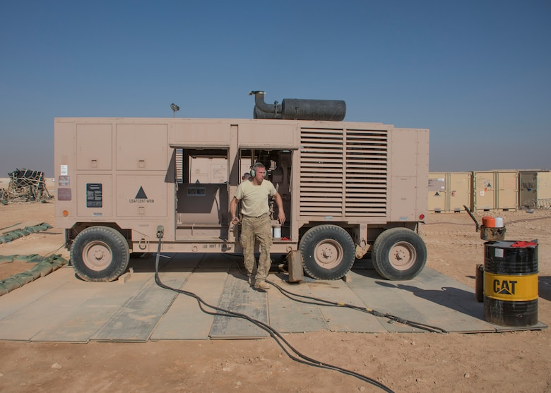 Staff Sgt. Gregory Speed, a 370th Air Expeditionary Advisory Group Detachment 1 electrician craftsman, exits a generator at Al Asad Air Base, Iraq Jan. 8, 2017. Preventive maintenance on these generators can take anywhere from an hour and a half to two hours to finish. (U.S. Air Force photo/Senior Airman Andrew Park)