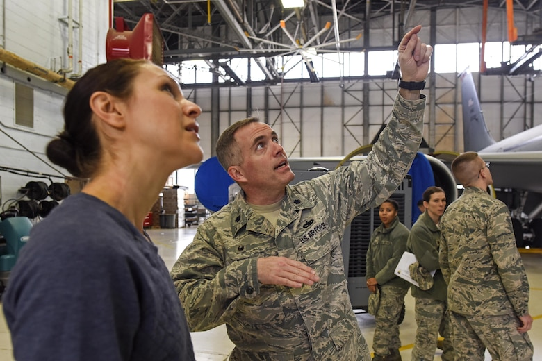 U.S. Air Force Lt. Col. Thomas Norris, 121st Air Refueling Wing Aircraft Maintenance Squadron Commander, gives a new recruit a tour of a KC-135 Stratotanker on Jan. 21, 2017 at Rickenbacker Air National Guard Base, Ohio. Lt. Col. Norris was recently awarded the 2017 Lieutenant General Leo Marquez Award of Maintenance Excellence for field grade officers for the Air National Guard. (U.S. Air National Guard photo by Senior Airman Wendy Kuhn)