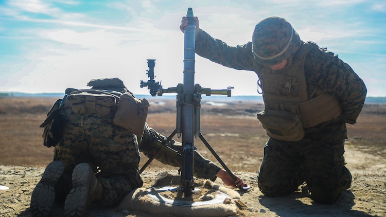 Marines with Task Force Southwest fire an M224 60mm mortar during a live-fire range at Marine Corps Base Camp Lejeune, North Carolina, Jan. 18, 2016. Task Force Southwest is comprised of about 300 Marines whose mission will be to train, advise and assist the Afghan National Army 215th Corps and the 505th Zone National Police. The unit is scheduled to deploy in the Spring.