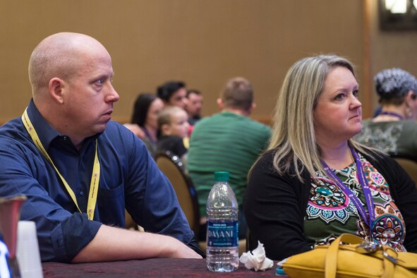 Senior Master Sgt. Mike Bier, 934th Security Forces Squadron superintendent, stationed at Minneapolis-St. Paul Air Reserve Station, Minnesota, and his guest Stephanie Woodward, participate in a breakout session at a Yellow Ribbon Reintegration Program event in Denver, Jan 22, 2016. The Yellow Ribbon Reintegration Program promotes the well-being of reservists and their families by connecting them with resources before and after deployments. (U.S. Air Force photo/Tech. Sgt. Benjamin Mota)