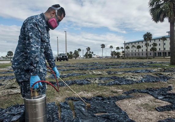 170123-WZ792-022 (Jan. 23, 2017) MAYPORT, Fla. - Hospital Corpsman 3rd Class Joshua Nieto of Navy Entomology Center of Excellence (NECE) Jacksonville, Fla.,  applies the insect repellant Permethrin to uniforms at Naval Station Mayport, Fla. Treating uniforms is one of many preparations  service members are taking before departing on Continuing Promise 2017 (CP-17). Continuing Promise 2017 is a U.S. Southern Command-sponsored and U.S. Naval Forces Southern Command/U.S. 4th Fleet-conducted deployment to conduct civil-military operations including humanitarian assistance, training engagements, and medical, dental, and veterinary support in an effort to show U.S. support and commitment to Central and South America. (U.S. Navy Combat Camera photo by Mass Communication Specialist 2nd Class Ridge Leoni)