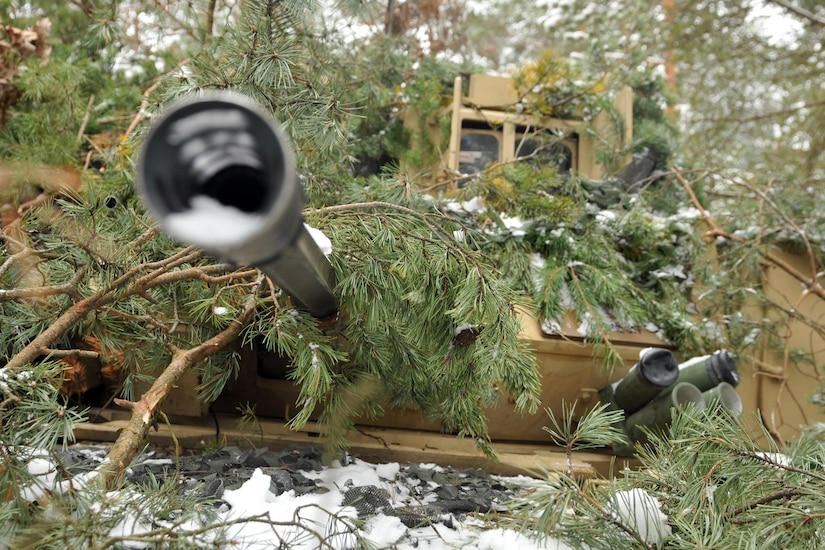 Soldiers assigned to 1st Battalion, 68th Armor Regiment, 3rd Armored Brigade, 4th Infantry Division conceal a Bradley fighting vehicle in wooded terrain at Presidential Range in Swietozow, Poland, Jan. 20, 2017. The soldiers and vehicles are in Poland as part of a nine-month deployment in support of Operation Atlantic Resolve. Army photo by Staff Sgt. Elizabeth Tarr