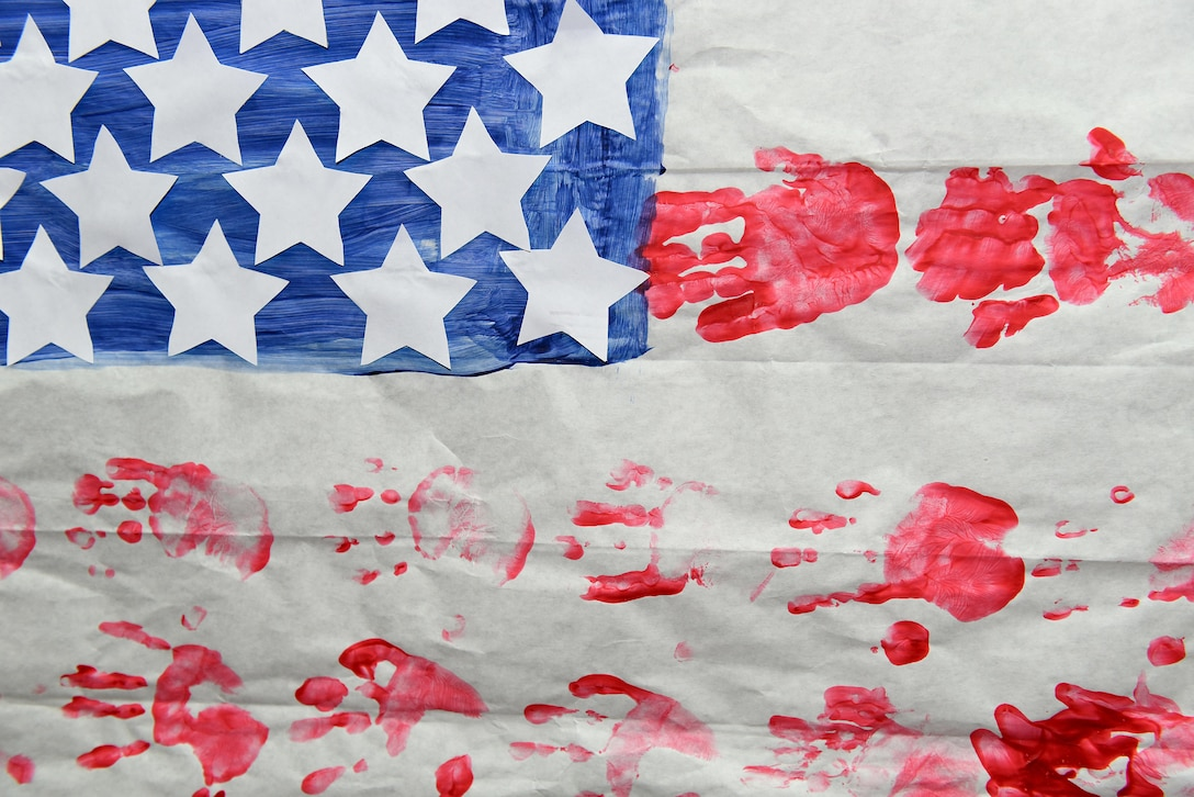 An American flag created from hand prints by elementary school childern in east Tennessee for appreciation to a service member hangs on a wall at the I.G. Brown Training and Education Center in Louisville, Tenn. (U.S. Air National Guard photo by Master Sgt. Mike R. Smith)