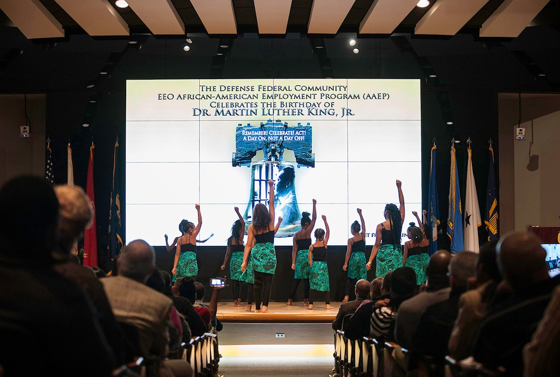 The Columbus Optimistic Ladies perform a dance routine during the Dr. Martin Luther King Jr. birthday observance ceremony at Defense Supply Center Columbus. The Jan. 19 event featured music, performances, and a presentation honoring the life and legacy of Dr. King.
