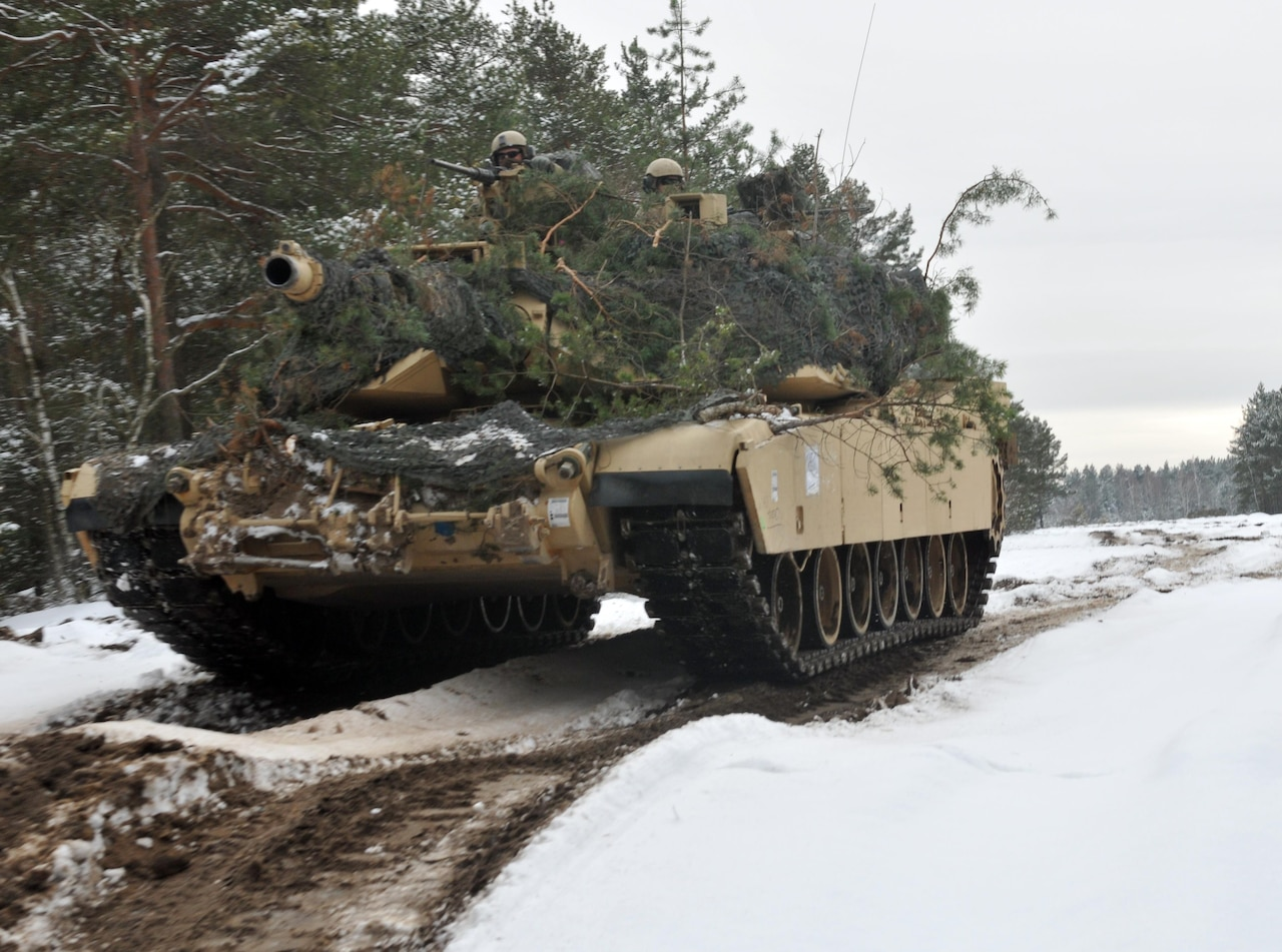 An M1 Abrams tank emerges out of wooded terrain after soldiers assigned to the 4th Infantry Division's 1st Battalion, 68th Armor Regiment, 3rd Armored Brigade Combat Team had concealed it to blend in with the surrounding environment at Presidential Range in Swietozow, Poland, Jan. 20, 2017. The vehicles and soldiers are part of a nine-month deployment in support of Operation Atlantic Resolve. Army photo by Staff Sgt. Elizabeth Tarr