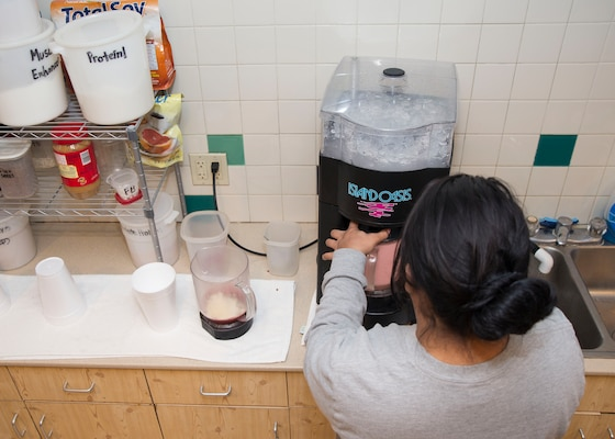 Jaimee Diaz, Force Fitness Bar day manager, blends a protein smoothie for a customer at Joint Base San Antonio-Randolph Jan. 20, 2017. The Institute of Medicine recommends adults 19 years of age and older get 10 percent to 35 percent of their daily calories from protein. (U.S. Air Force photo by Airman 1st Class Lauren Parsons/Released)