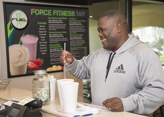 Reginald Creech, Force Fitness Bar customer, receives a protein smoothie following a workout at the Rambler Fitness Center on Joint Base San Antonio-Randolph Jan. 20, 2017. The Recommended Dietary Allowance (RDA), the amount of a nutrient an individual needs to meet basic nutritional requirements, suggests that protein is more effective if consumption is spaced out over the day's meals and snacks, rather than loading up during any one meal. (U.S. Air Force photo by Airman 1st Class Lauren Parsons/Released)