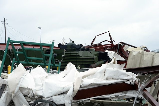 An assault amphibious vehicle stands alone in the rubble of a damaged warehouse destroyed by a tornado that struck Marine Corps Logistics Base Albany, Jan. 23, 2017. A line of strong thunderstorms produced a tornado that passed through the Albany, Georgia community and Marine Corps Logistics Base Albany carving a path of destruction leaving the landscape strewn with broken trees, downed power lines and damaged structures, Jan. 22, 2017.
