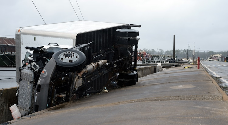A 3-ton government vehicle is overturned in a drainage ditch following the impact of a tornado on Marine Corps Logistics Base Albany, Jan. 23, 2017. A line of strong thunderstorms produced a tornado that passed through the Albany, Georgia community and Marine Corps Logistics Base Albany carving a path of destruction leaving the landscape strewn with broken trees, downed power lines and damaged structures, Jan. 22, 2017.
