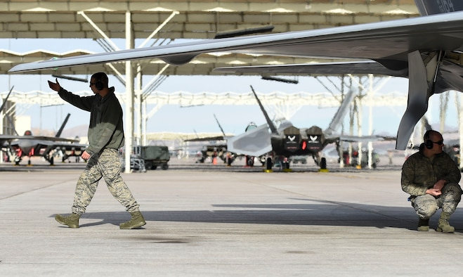 U.S. Air Force Airmen assigned to the 1st Aircraft Maintenance Squadron, Langley Air Force Base, Virginia conduct post flight checks on  F-22 Raptors at Nellis AFB, Nev., Feb. 18, 2017. The 27th Fighter Squadron's aircraft arrived to participate in Red Flag 17-1, an exercise held four times a year that provides aircrews the experience of multiple, intensive air combat sorties in a safe training environment. (U.S. Air Force photo by Staff Sgt. Natasha Stannard)