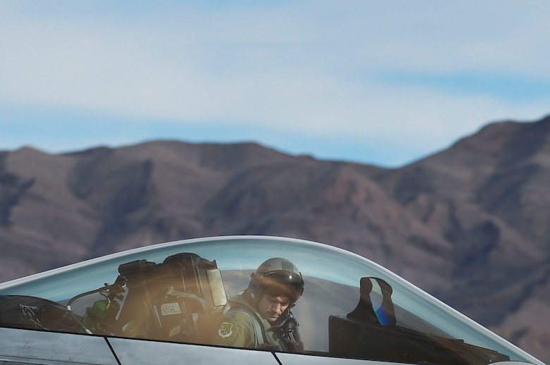 U.S. Air Force Col. Peter Fesler, 1st Fighter Wing commander, arrives to Nellis Air Force Base, Nev., Feb. 18, 2017, to participate in Red Flag 17-1. Red Flag is the U.S. Air Force's premier joint and allied force air-to-air combat training exercise. (U.S. Air Force photo by Staff Sgt. Natasha Stannard)