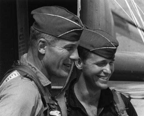Then Col. Robin Olds and Capt. J.B. Stone celebrate after returning from Operation BOLO. (U.S. Air Force photo.)