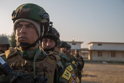 Iraqi forces soldiers wait to begin training at Camp Taji, Iraq, Jan. 22, 2017. The soldiers were learning from coalition personnel how to search personnel and vehicles for improvised explosive devices. Army photo by Spc. Christopher Brecht