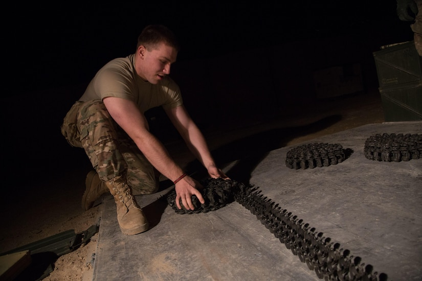 Army Spc. Ivan Celley rolls an ammunition belt for a land–based Phalanx weapon system at Camp Manion, Iraq, Jan 7, 2017. Celley is assigned to Bravo Battery, 5th Battalion, 5th Air Defense Artillery Regiment, The Phalanx is a rapid-fire, computer-controlled, radar-guided gun system designed to defeat anti-ship missiles and other close-in air and surface threats. Army photo by Spc. Christopher Brecht